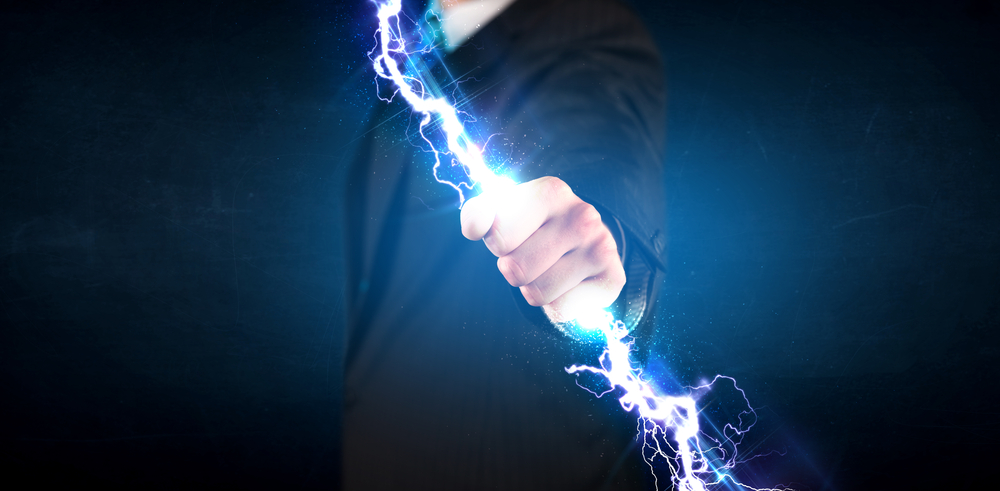 Business man holding electricity light bolt in his hands concept.jpeg